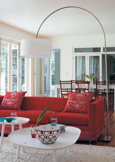 love the red and white - love the sofa and lamp...