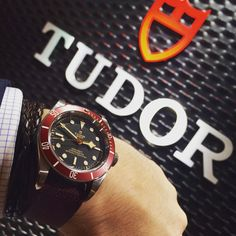 New red/ black Tudor additionnal fabric strap available on Tudor Black Bay. Note the 3 lines, as it is now an officialy certified chronometer (COSC) with Tudor in-house movement   #Tudorwatch #blackbay #wristshot #blackbaydark #Baselworld2016 #watch #watches #watchoftheday #watchesofinstagram #instawatch