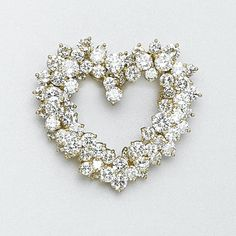 DIAMOND HEART BROOCH, TIFFANY CO. Set with 67 round diamonds weighing approximately carats, mounted in 18 karat gold, signed Tiffany. With signed box. I Love Jewelry, Heart Jewelry, Jewelry Ideas, I Love Heart, Tiffany Jewelry, Tiffany And Co, Diamond Are A Girls Best Friend, Diamond Heart, Round Diamonds