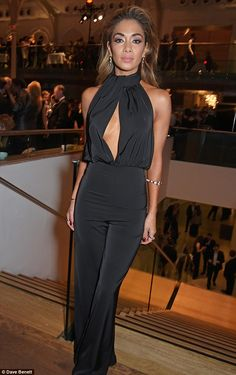 Another outfit: Nicole Scherzinger poured her toned curves into a slinky black jumpsuit...