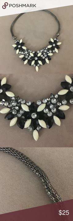 "Statement necklace black white floral rhinestones Trendy and sophisticated statement necklace featuring black and off-white beaded flowers with clear and gray rhinestone centers and accenting leaves. Chain is a pewter gray round woven chain with 2.5"" adjustable clasp in the back.   Chain length 13"" - 15.5"" long and 1/8"" thick. Statement necklace design is 2"" wide 7"" inches long. Jewelry Necklaces"