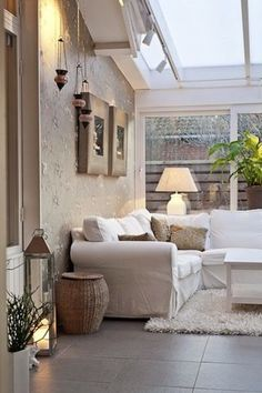 CONSERVATORY - needs to be on the North / East side of the house, so cool in the evening .Getting a similar family room extension on my house soon.love the couch style.but the I couldn't have a white couch with 4 kids! Home Living Room, Living Area, Living Spaces, Style At Home, Conservatory Decor, Conservatory Interiors, Interior And Exterior, Interior Design, Home And Deco