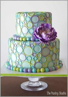 Lovely colors and design, fondant cake.