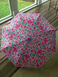 Lilly Pulitzer lucky charms umbrella - too cute, I need pink rain boots to match!