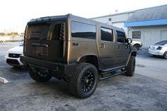 Hummer H2 Matte Black Truck Wrap Miami Florida  http://carwrapsolutions.com/matte-black-wrap-carbon-fiber-racing-stripe.html