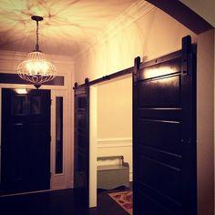 Entryway. Barn Doors. Light Fixture.