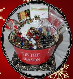 Santa Cookie Basket   Have you ever wondered about the variety of cookies Santa has on Christmas Eve as he travels around the world delivering presents to all the good boys and girls.   The Santa Cookie Basket has a sampling from France, Germany, Belgium, Italy and The Netherlands. All decked out in a seasonal tin bowl with a cookie plate, napkins, a small sack of candy and a candy cane.   CB008   $39.99 Christmas Gift Baskets, Christmas Eve, Christmas Bulbs, Christmas Gifts, Cookie Baskets, Santa Cookies, Tis The Season, Candy Cane, Belgium