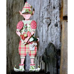 Create this fun Mixed Media Art Doll using new dies from AccuCut. The elf is here just in time for Christmas crafting of all kinds. See more at www.accucutcraft.com