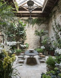 The garden conservatory is a well-loved family gathering spot, used for reading, lounging, dining, and entertaining.