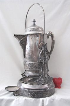 The Victorians had a piece of tableware for every single thing - from toothpicks, napkin holders to special containers for water.  This is a water pitcher.  It would have had a matching cup - either silver or glass.  So gorgeous...and I would think useful today.  Serve water or a cold beverage during a dinner party...