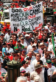 Save our Souths. Photo of South Sydney fans marching through the streets of Sydney. Two of the fans are holding a banner which reads 'Save our club and our game, preserve our culture and our name. No Real Loyalty' Australian Rugby League, Loyalty, League Of Legends, Rabbits, Preserve, Cheerleading, Crowd, Sydney, Tennis
