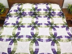 Double Wedding Ring Quilt. A favorite Lancaster quilt design with lovely lavender and green cotton prints. Note the care taken with the piecework and quilting by the Lancaster Amish woman who made it. The quilted hearts are extraordinary!