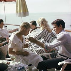 Alain Delon and Romy Schneider, Cannes 1959  by alaindelon | via ysvoice | notanlines