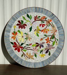 MOSAIC TABLE colorful dancing flowers stained glass mosaic art table top or wall piece WHITE by ParadiseMosaics on Etsy https://www.etsy.com/listing/222202172/mosaic-table-colorful-dancing-flowers