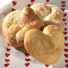 Lemon Love Buns ~ These are quintessential hot yeast buns -- but with an unexpected and refreshing jolt of citrus. The citrus essence elevates them beyond ordinary dinner rolls to something special: tea or breakfast rolls, perfect for spreading with homemade preserves (we recommend raspberry highly).
