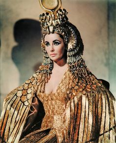 Gold Fashion-  Elizabeth Taylor dressed in Gold ~ burlesque style.