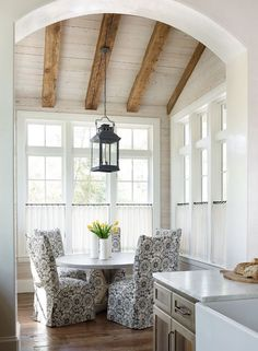 Light filled breakfast nook with upholstered chairs
