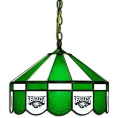 Imperial Philadelphia Eagles Licensed 16-Inch Diameter Stained Glass Pub Light. 18-40+14 Team: Philadelphia Eagles, Style: Direct Wire Add some class to your game room with the NFL Team Logo Stained Glass Pub Light. Each piece of glass is hand cut and soldered into its proper place with great care and precision. Your favorite football team's logo is screen printed directly onto the glass in coordinating team colors. The high quality NFL Team Logo Stained Glass Pub Light will be a hit in your…