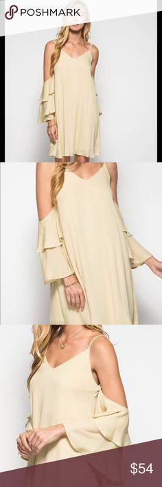Double Layered Swing Dress Beautiful double layered bell sleeve swing dress with a cold shoulder cut! Dreamy gauze material is light and wispy. Dress this up or down Spring through Fall!! Pale Mustard is in the beige tone! 100% Polyester material! Garment Care: Hand Wash! Dresses Mini