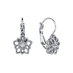 Delicate and lovely star earrings state a romantic and whimsy feeling for any woman. Lightly antiqued silver tone filigree is set with a glimmering crystal center, gleaming with fire like a genuine diamond. Glamorous and flirty!