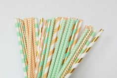 Set of assorted peach, mint green and gold paper straws. The assortment includes: ♥ gold foil chevron paper straws ♥ gold foil swirl paper straws ♥ mint green and gold foil swirl stripe paper straws ♥ mint green chevron paper straws ♥ mint green stripe paper straws ♥ peach chevron paper straws ♥ peach w/ white polka dots paper straws ♥ peach swirl stripe paper straws  These paper straws would be perfect for a birthday party, baby shower, wedding, bridal shower or really any special event...