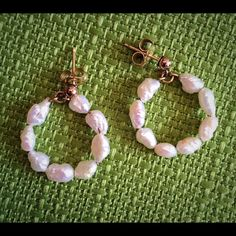 "Vintage 14K Genuine Pearl Hoop Earrings Up for sale is a lovely, bridal perfect pair of 14k gold and genuine pearl hoop earrings.  They have a nice luster and are for pierced ears.  Approximately 3/4"" in size.  The backs are marked 14k and post tested pos"