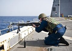Gunner's Mate 2nd Class Taylor Perkins fires an M240B machine gun on the flight deck, during a quick draw drill aboard the amphibious transport dock ship USS New York (LPD 21). (U.S. Navy photo by Mass Communication Specialist 3rd Class Ian Carver/Released)