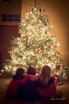 O Christmas Tree........This photo reminds me of Christmas when my kids were still at home. We had three and just like the photo two girls and a boy and he was the middle child as well. Great Memories!