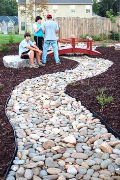 Rain Water Run Off Problem Solved With A Gorgeous Dry Creek Bed Anese Bridge Note How Ends At Garden Up Against Fence Makes