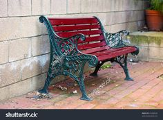 Iron and Wood Garden Bench painted Green and Red, with small depth of field by Cloudia Spinner, via Shutterstock