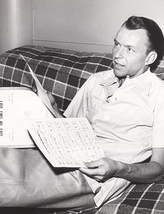 """Frank Sinatra looking over the music for """"Day In, Day Out"""" on the set of From Here to Eternity, 1953"""