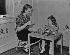 1930: A mother enjoying a tea party with her young daughter.:  27 Awesome Vintage Photos of Moms   Mental Floss