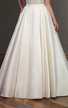 Elegant and tradition, the Sonny skirt adds a touch of glamor to any bridal style. Available in a range of fabrics and colors, this skirt is perfect for a bride wants to give her bridal style a personal touch. A voluminous silhouette creates a romantic feel as a substantial train carries the look from ordinary to extraordinary. The Sonny skirt zips up in the back with no buttons for a seamless transition from top to skirt.