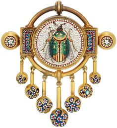 Antique Gold and Micromosaic Fringe Pendant-Brooch.     Centering a circular white tesserae panel depicting a multicolored tesserae beetle accented by gold, encircled by red and white tesserae, within a double row of rope-twist gold, flanked and tipped by rectangular and circular panels decorated with multicolored tesserae in a geometric pattern, suspending a seven strand gold fringe tipped by gold balls set with blue, red and white tesserae florets, circa 1860. Via Doyle New York.