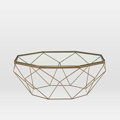 Simple and sculptural, this coffee table combines a geometric iron base with a glass top for an airy vibe. x x Tempered glass top. Iron base in. Narrow Coffee Table, Oval Coffee Tables, Brass Coffee Table, Outdoor Coffee Tables, Coffee Table With Storage, Coffee Canister, Coffee Cups, Coffee Beans, Coffee Pot Cleaning