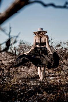 She walks into the shadows