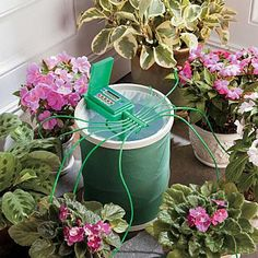 Automatic Plant Watering System waters up to 10 potted plants while you're away.    No need to bother a neighbor. This unique Automatic Plant Watering System does the watering for you. Just attach the battery-operated pump to the included coil spring bucket, fill with water, and run tubing (32-1/2 feet included) from the plant watering system to each plant, cutting enough tube to comfortably reach the soil and securing in place with a clip. (10 clips included.) The 4-gallon bucket has a coil…
