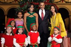 """Going Green  Obama wore a festive, green Cushnie et Ochs dress for the """"Christmas in Washington"""" celebration at the National Building Museum in Washington on Dec. 11, 2011."""