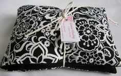 White on Black Floral Heat Pillow, Perfect for aches and pain or keeping warm.