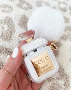 The cutest chanel perfume inspired AirPod case ever! Cute Ipod Cases, Girly Phone Cases, Iphone Phone Cases, Aesthetic Phone Case, Accessoires Iphone, Chanel Perfume, Earphone Case, Airpod Case, Iphone Accessories