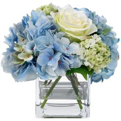 A rejuvenating arrangement of lifelike blue hydrangea and white roses by Diane James lends a summery look year-round.