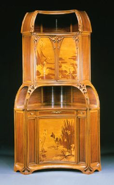 Louis Majorelle (French, 1859–1926), Nancy, Encoignure, Mahogany, Fruit Wood Inlays and Glass, 1900.