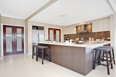 The base cabinets are too brown but it gives you an idea of what your combination might look like; darker coloured lower cabinets, white benchtop, splash back in a similar tone to lower cabinets & white upper cabinets.