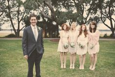 love this shot of the groom with the bridesmaids in a row in the background http://su.pr/2hGABd rustic wedding photos by Claire Eliza