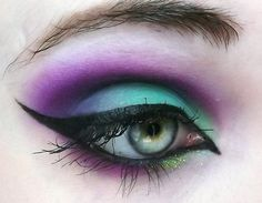 Definitely feeling the need to rock ultraviolet and vivid greens with my new crazy red hair. And that dash of light green glitter below? Genius.