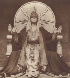 Mia May German Silent Film - Die Herrin Der Welt (The mistress of the world) 1919 She is sitting on a throne with the symbol for Shamash (a native Mesopotamian deity and the Sun god in the Akkadian, Assyrian, Babylonian, and Canaanite pantheons) Photo Print, Mystique, Silent Film, Coven, Vintage Photography, Historical Photos, Dark Art, Witchcraft, Creepy
