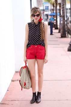 Polka dot shirt, red shorts, ankle boots