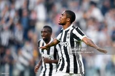 Douglas Costa celebrates 1-0 goal during the Serie A match between Juventus and SS Lazio on October 14, 2017 in Turin, Italy.