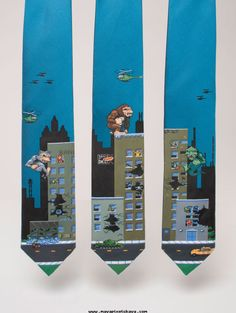 I mostly have memories of playing Rampage on a friends Commodore 64, wanting to play the gorilla character, since I was a King Kong fan more than a Godzilla fan ;). Would love to see three guys wearing these in sequence. Rampage video game themed ties