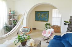 Seriously, the hammock, the sofa, and that wall map!!! The chest/table, the metal stand, the eclectic chairs.... Sigh....